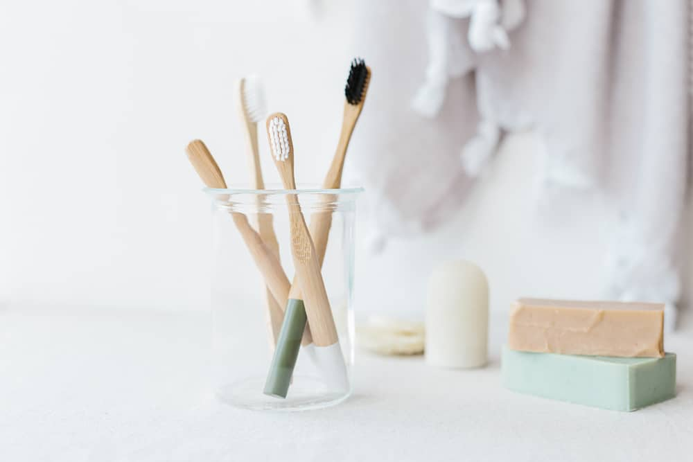 Bamboo toothbrushes in glass cup