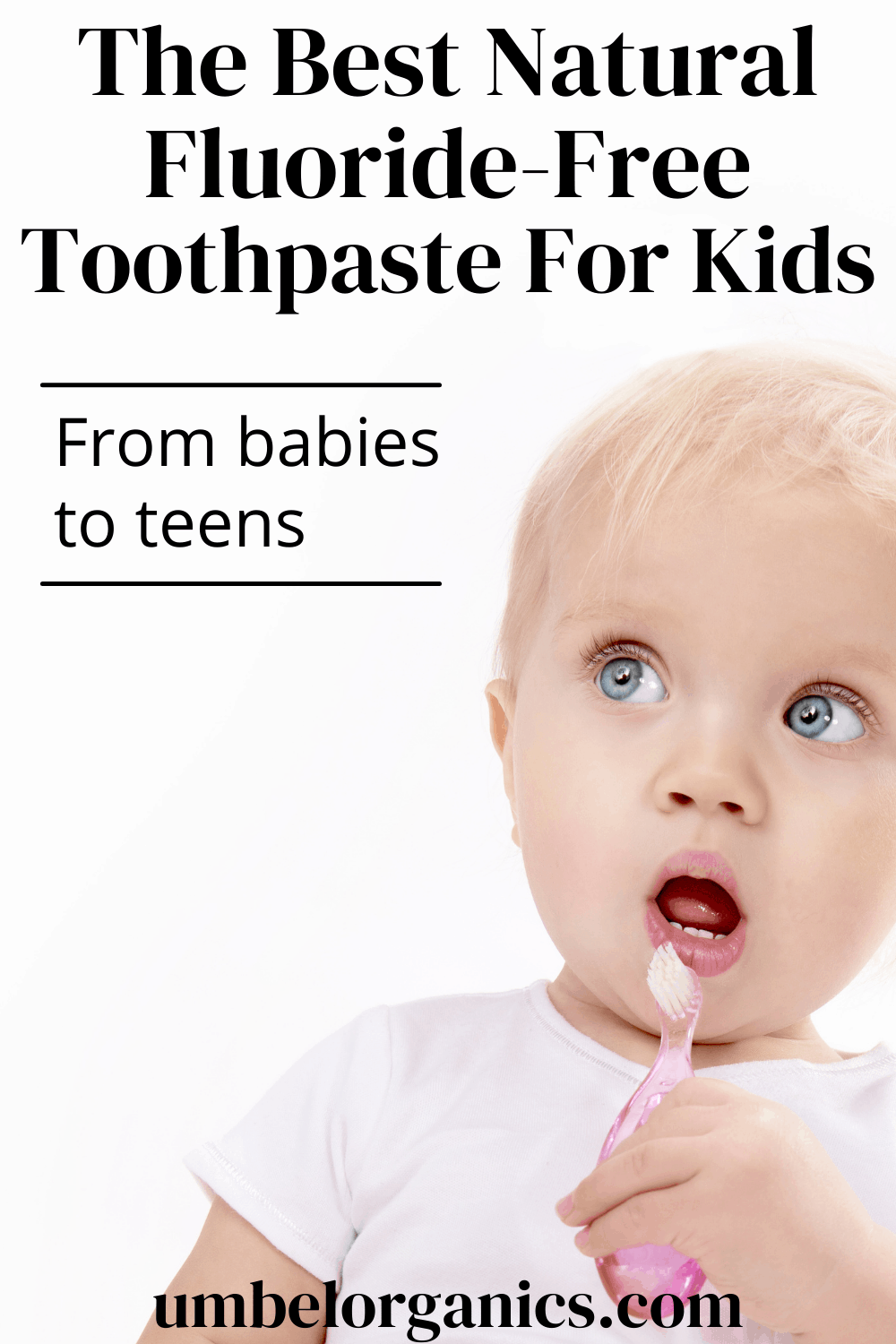 Blond baby holding pink toothbrush up to mouth