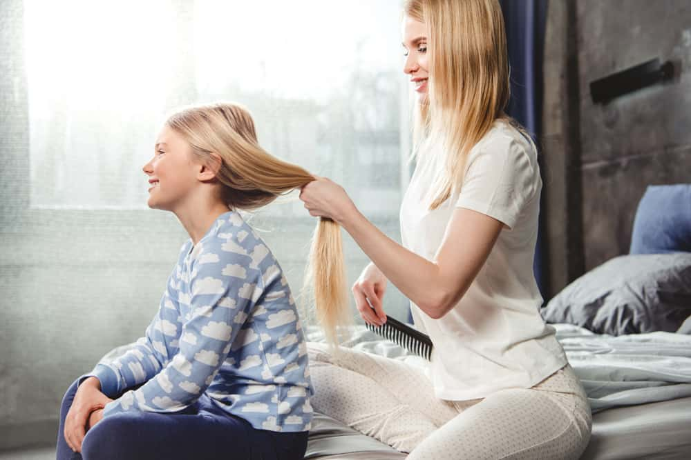 Mom Combing Daughter's Hair